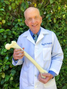 Roy Meals holding a femur