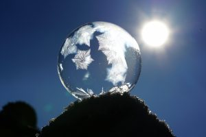 crystal ball with snow and sun