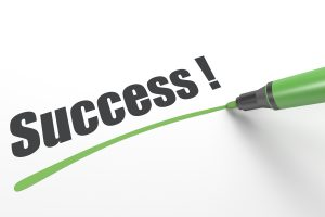 """the word """"Success!"""" being underlined with a green pen"""